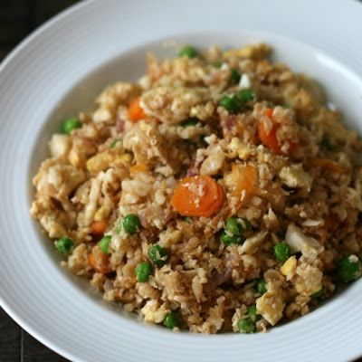 "Cauliflower Fried ""Rice""  Made this tonight with grilled chicken!  So good!  I didn't measure anything and I used a bag of frozen veggies (peas, carrots, corn and green beans) - it seems like a very flexible recipe  :)"