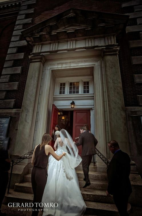 Bride arriving to St. Augustine Church, Philadelphia. Reception at Vie. Candid moment captured by Gerard Tomko.