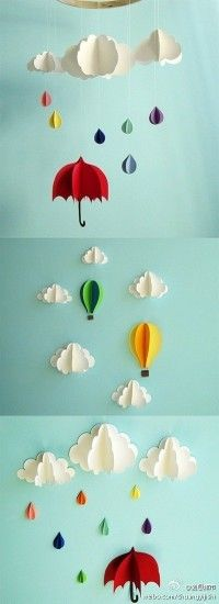 paper clouds, raindrops, umbrellas This would be fun for party decorations.- or