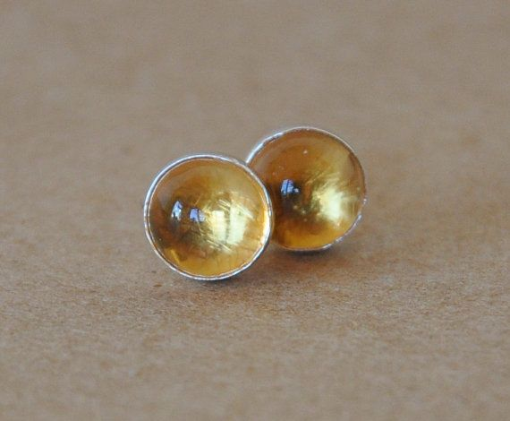 Citrine Earrings handmade with sterling silver studs. Beautiful golden yellow Citrine and Silver Earrings. 6mm Citrine gemstone is the stone of success. These Earrings would be great for someone as bright and sunny as these gemstones look. These Citrine earrings were handmade in my