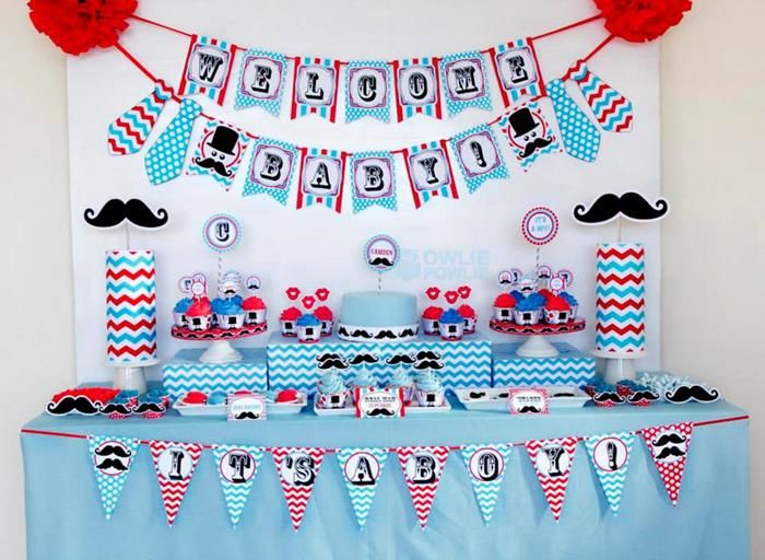A cool desert table with moustache cookies, cool DIY signs, wall hangers, cakes etc. Find more themes on our blog and also discover cool spaces to execute these themes from Venuerific. www.venuerific.com