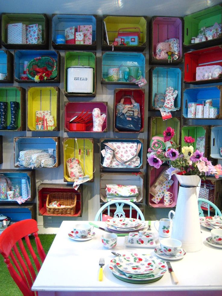 Kath kidson store using crates as shelves brightly for Painted crate ideas