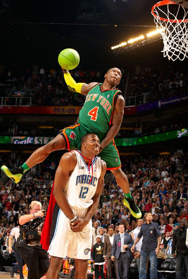 """Nate Robinson, donning a green uniform (complete with shoes and matching ball) to play the role of """"krypto-Nate"""" to defending champ Dwight Howard's Superman, went on to win his second NBA Slam Dunk..."""
