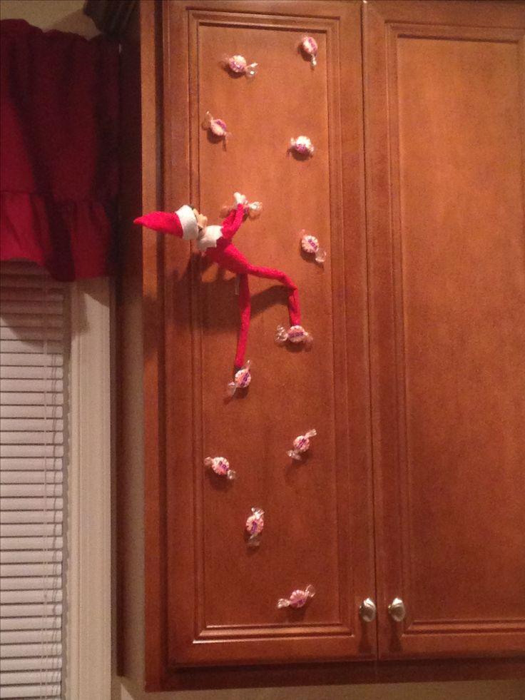 elf on the shelf - candy rock climbing