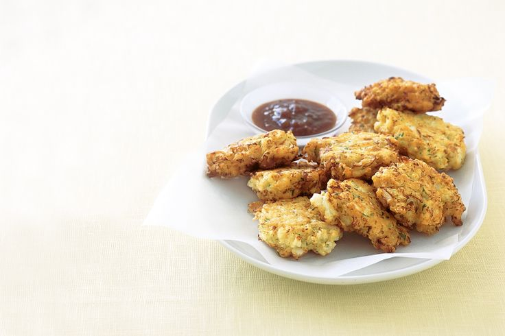 Get the kids to love their vegetables with these cheesy cauliflower fritters.