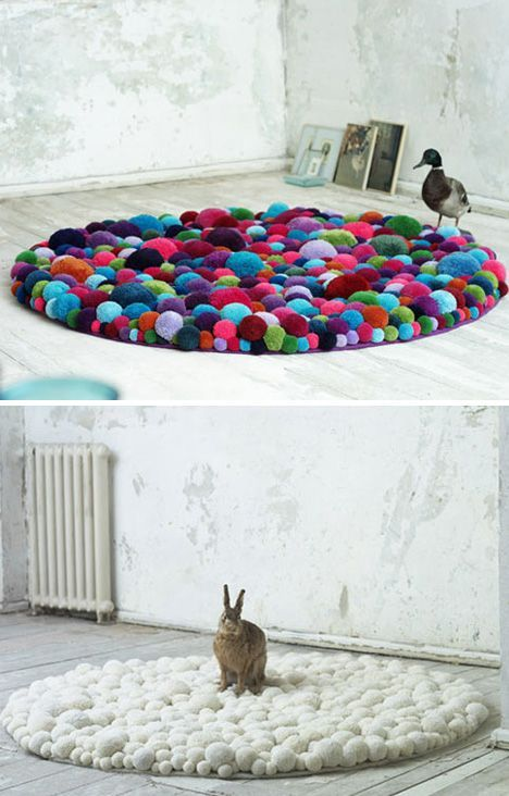 poof round rugs made of pompoms:-) What a cute hackable way to use up little end bits of yarn! I would just stitch them down to cross-stitch fabric and then add an underlay.