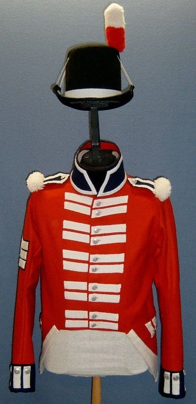 A recreated Royal Marine sergeant's jacket and hat (front view) Note the plain white lace rather than the regimental lace Corporals and Privates have on their jackets. This would be after the introduction of chevrons to mark the NCO ranks in 1807, too.