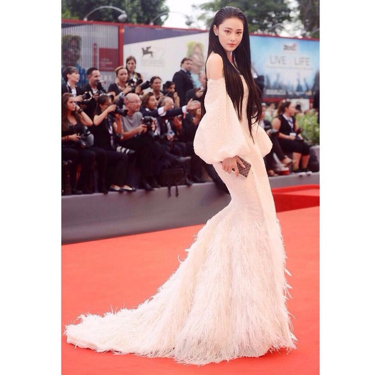 """""""Chinese Actress Viann zhang looks stunning in an Ashi Studio off white embroided Feather Couture Dress at the Red Carpet of Everest film premiere at the…"""""""
