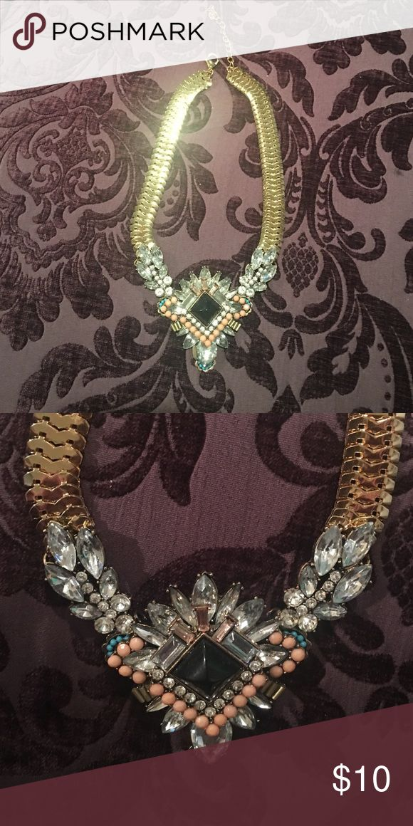 Statement necklace with thick gold chain Statement necklace with jewels and thick black chain. Jewel colors are rhinestone peach and a hint of teal. Jewelry Necklaces