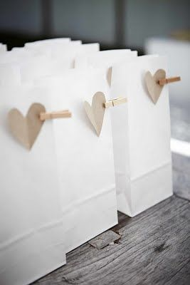 Wedding favours - paper bags with brown hearts, could double up as name tag. Quick, easy and cost effective. What would you put in them?