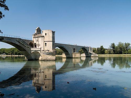 St.+Benezet+Bridge,+Avignon+-+A+famous+Avignon+landmark,+this+old+bridge+extends+half+way+across+the+river+and+houses+a+small+church.