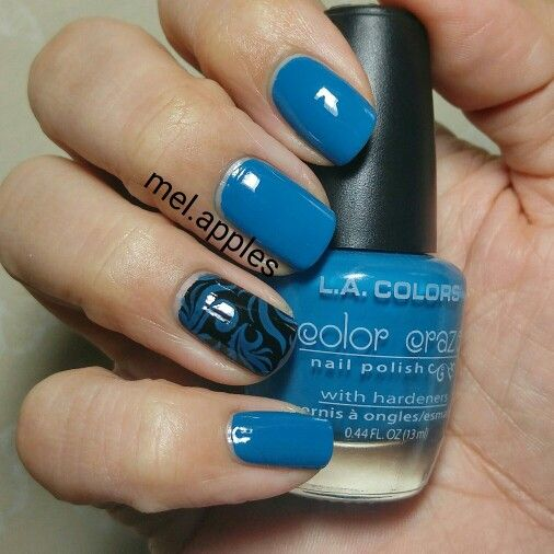 L.A. Colors Color Craze - Aquatic CNP508 (A). Blue teal cream. Shown here with two coats. Nearly covers in one. Thicker than some other cream formulas from this brand. Shown on ring finger stamped over black!  This one did slightly stain my cuticles upon removal.