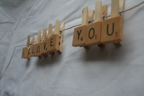 Photo hanger made with scrabble tiles