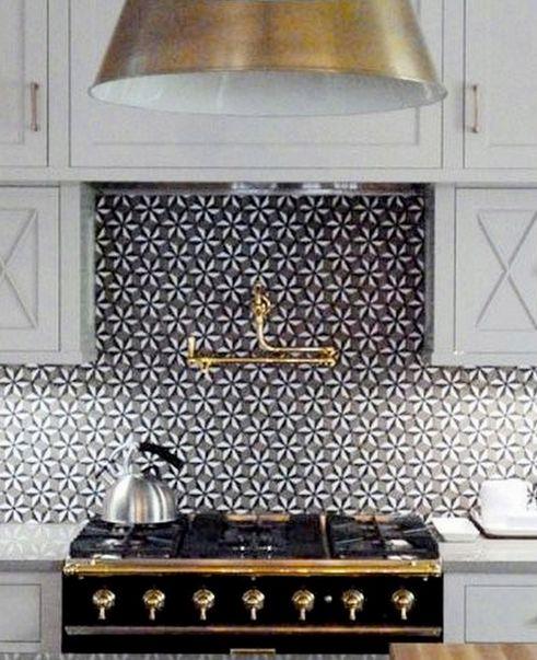 Black and White tiled kitchen.