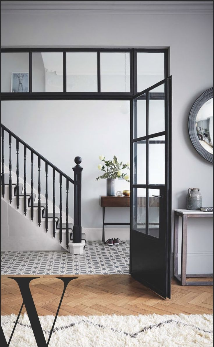 Stunning banisters in Farrow & Ball Railings with pale walls (F&B Blackened).  Sommer Pyne's hallway @housecurious. Photo: Paul Massey for  Living Etc Feb 2017