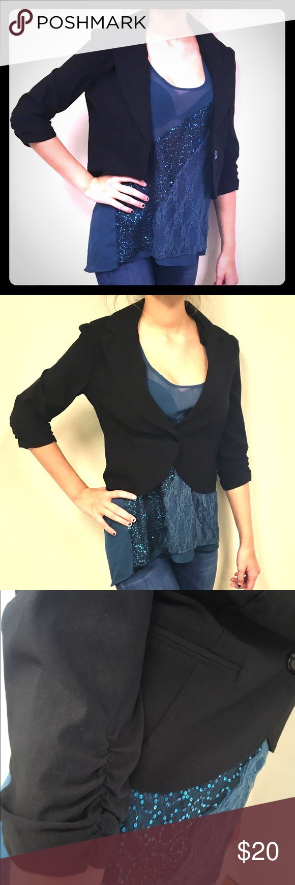 """Short Sexy Fun and Fitted Black Blazer This isn't your typical business jacket, but could definitely do the job if you needed it to. It's shorter, fitted to your waist line with ruching noted on the shorter 3 quarter length sleeves and accent buttons on the back. Also has 2 fake pockets on the front for decoration. Model is 5'9"""" only jacket pictured is for sell here, shirt is also for sell for a great bundle! Extra button sewn on inside if ever needed. B•Wear Jackets & Coats Blazers"""