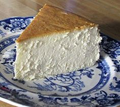 The single best cheesecake I have ever had. You may have noticed that this cheesecake does not have any kind of crust, neither bottom or sides. You may also have noticed that there are no cracks in the top.  That is because this cheesecake is baked in a bain-marie, a water bath. This is one of the secrets to a truly creamy cheesecake.