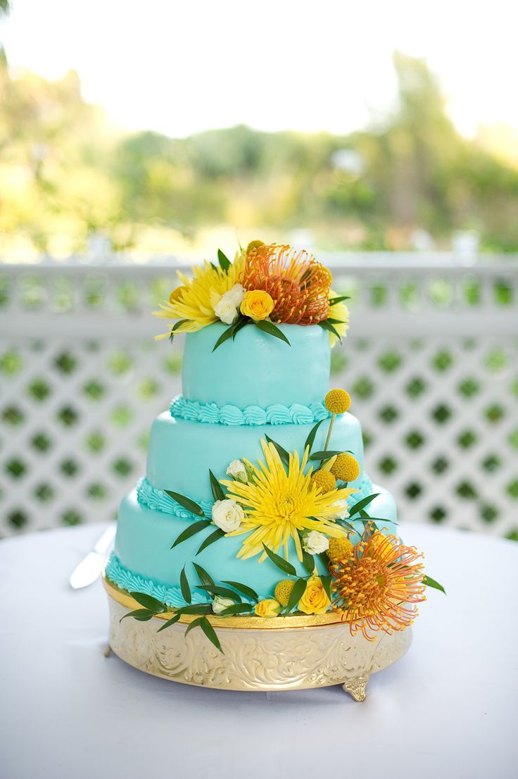 Maybe fits color pallet @Lauren Erickson ? I like that the cake is colored, and small :) I'm always afraid a lot of cake goes to waste..    tropical themed wedding flutter glass photography61