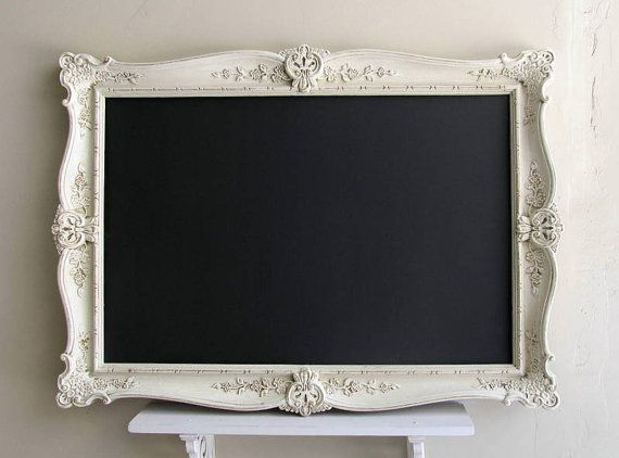 Find an old mirror on kijiji, paint the frame white and paint the glass with black magnetic chalkboard paint!