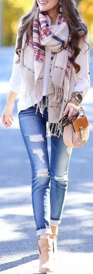 Tan Suede Booties + Ripped Jeans + White Blouse + Statement Aztec Scarf                                                                             Source