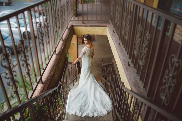 That dress!! Our bride's long sleeve vintage lace wedding dress was the perfect gown for her vintage wedding. Click to see more details from this vintage wedding at the Hemet Ryan Airport in San Diego, CA | Always Flawless Productions | San Diego's Best Wedding Planners & Coordinators