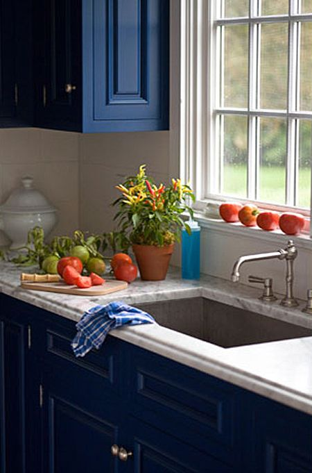 "Blue Kitchen Inspiration | photo Quentin Bacon for House Beautiful | House & Home.  ""White Carrara marble countertops, finished with a traditional ogee edge, set off cabinets painted Benjamin Moore's Champion Cobalt...""  http://www.housebeautiful.com/kitchens/dream/blue-kitchen#slide-1  I love this :)"