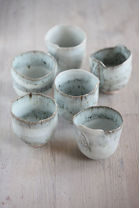 Hand built stoneware and Porcelain cup or deep bowl with pretty blue glaze Beautiful blue glaze- super pretty, rustic and translucent. Great unique tea bowl or saki cup, pea pod pattern on side of some.  food safe, and water tight, dishwasher, oven and microwave safe.  size width 3 height 3  This listing includes 6 cups.  Signed with my chop on the bottom.