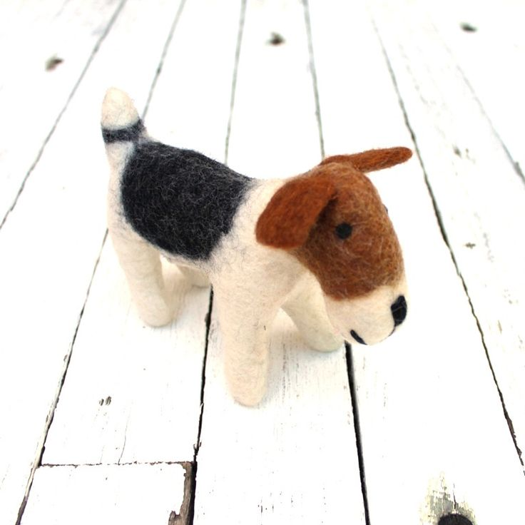 Meet our most popular small felt toy - our gorgeous felt puppy dog. He is calm and obedient, and loves to cuddle next to you while you read a book or watch TV. He is also a little bit of a show pony and enjoys posing on your favourite mantle.Our felt toy dog is a handmade alternative gift that satisfies long after the proverbial box has dust on it.This felt toy is child safe, as there are no pieces that can fall off and cause a choking hazard. All features are sewn on.FIBRE:Hand felted WOOL…
