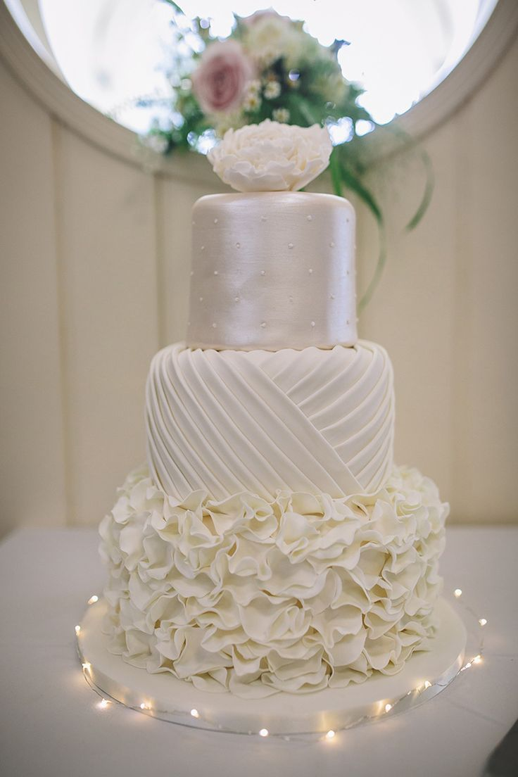Pearl Ruffle White Cake Iced Darling Pale Pastels Conservatory Wedding http://storyandcolour.co.uk/