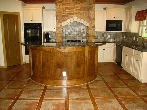 kitchen floors tile installation- wood and tile????  How do you clean?  Could use woodgrain tile in between and that would be ok.  Looks BOLD.  Too much for a small space though.