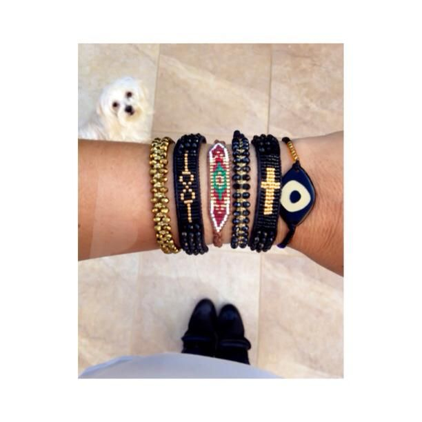 Find the intruder!.. #Didadi #black #gold #new #handmade #jewels #loom #bracelets #evil_eye #arm_party