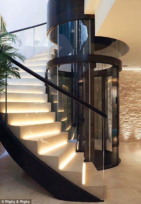 A lift shaft made of bronze and glass runs through all four storeys of the home…