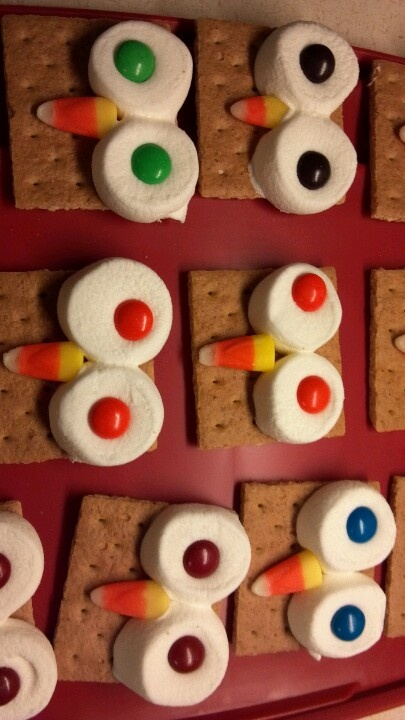 Owl snacks...So easy to make! Cut a marshmallow in half & put on half of a graham cracker. Put in microwave for 15-20 seconds. Put M's on for eyes and Candy Corn for nose. Once the marshmallow cools it all sticks together!
