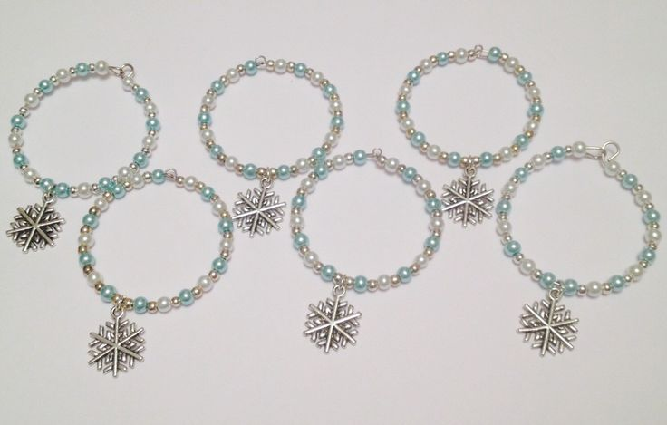 A personal favourite from my Etsy shop https://www.etsy.com/uk/listing/293211781/silver-snowflake-napkin-rings-serviette