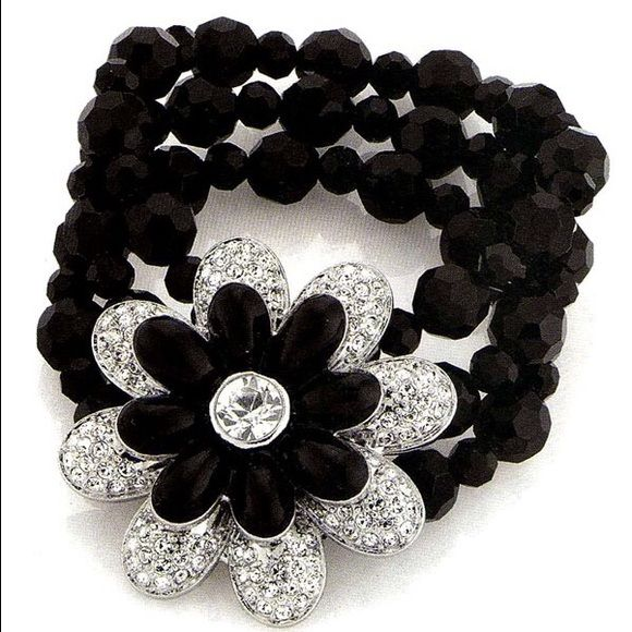 Lia Sophia Corsage Stretch Bracelet Lia Sophia Corsage Black Stretch Bracelet - Sparkling of jet black petals with clear cut crystals and centered surrounding clear solitaire - NWOT Lia Sophia Jewelry Bracelets
