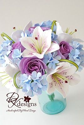 So realistic handcrafted clay flower wedding bouquet  in blue and purple.  See more purple and blue wedding inspiration: http://www.squidoo.com/purple-themed-wedding
