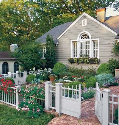 front yard garden--love it. could create a small garden from a big green yard with fence and plants