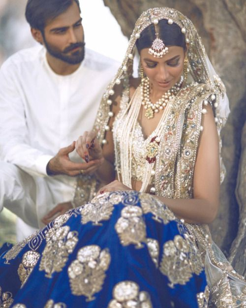 India | An untraditional blue and gold dress, looks perfect on the bride.