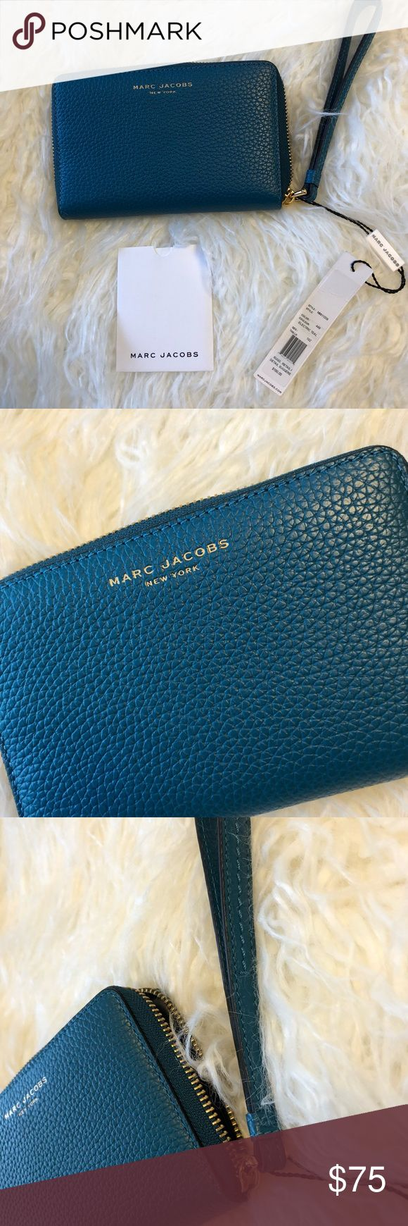 Marc Jacobs iPhone  wristlet Gorgeous teal pebble leather - With gold hardware. Measures 6 1/2 x 4. Has card slots spot for ID and Additional pockets . Fits in iPhone 7 or the iPhone 8 a smaller size. ( without a case on ) . I have the iPhone ate. And without my phones case on it the phone slides in perfectly to the side compartment. Teal is the color. Marc Jacobs Bags Clutches & Wristlets