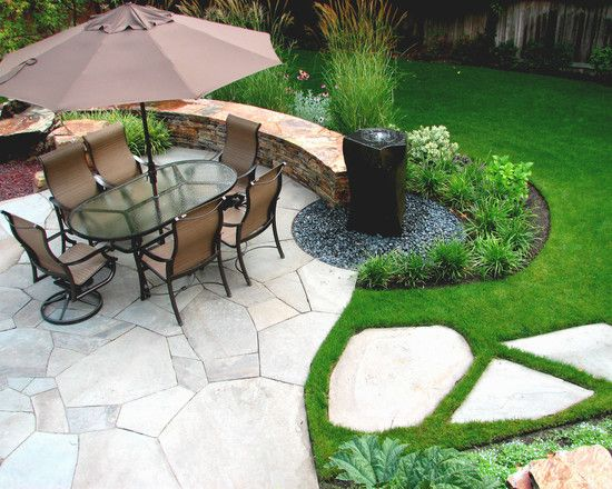 Natural Stone Patio with Fountain Landscaped at Perimeter