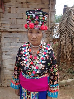 Hmong woman in Hmong-style clothing, but with Iu Mien embroidered designs on the jacket and hat