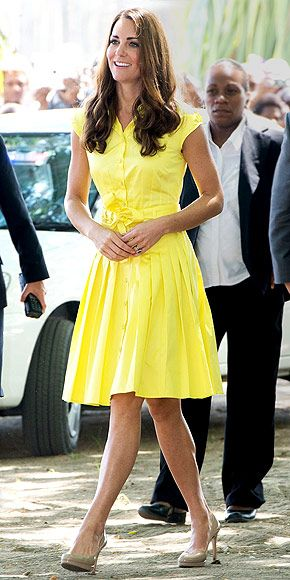 For Day 7 of her tour (also in the Solomon Islands), Kate glows in a yellow belted shirtdress and nude heels, plus enviably shiny hair. (Whatever product she's using to fight frizz, it's working!)