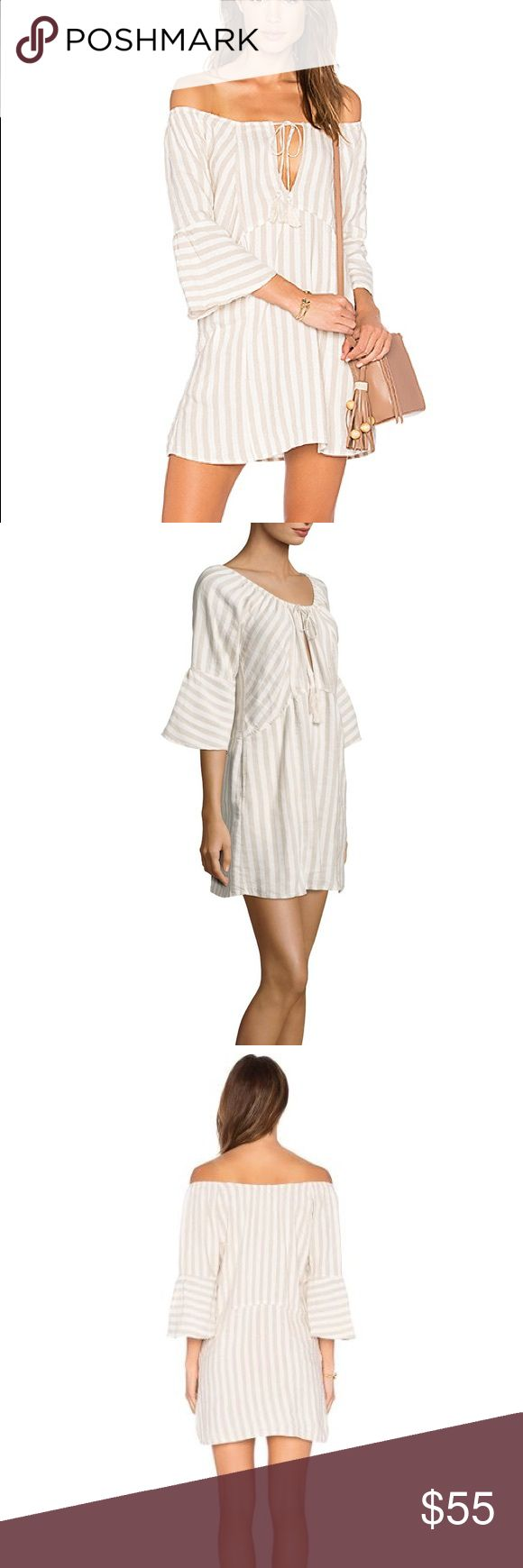 Free People Folk Town Boho Dress S Neutral stripes add to the rustic appeal of this crisp woven tunic by Free People. Featuring tassel-tipped neckline ties and flared sleeves, this summery mini dress is short and oh so sweet. 55% linen 45% rayon Unlined Front keyhole with tie closure Side seam pockets Flared sleeves Free People Dresses Mini
