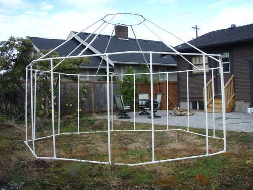 "pvc 'yurt' (tent) made with 24 x 45 degree joints, 24 T joints, 32 x 5"" pipes, 8 x 6"" pipes and 8 x 1"" pipes...  apparently it all packs down into a snowboard bag! (or any 6"" bag, really)"