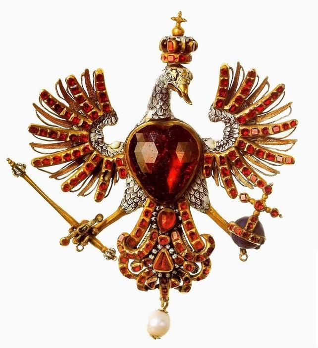 17th Century: Polish eagle with a garnet body; mid-17th century, Paris. This brooch in the shape of an eagle entered the collection of Louis XIV around 1669. It is decorated with rubies, pearls, and painted enamel. The jewel represents the emblem of Poland and symbolizes the close links between the French and Polish monarchies in the 17th century. Found this image from louvre.fr, but pinned from Wikimedia.org