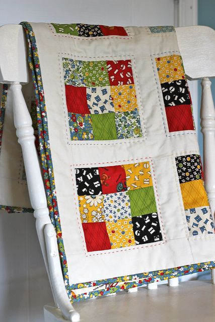 American Jane 9 Patch Baby Quilt by CoraQuilts~Carla, via Flickr. I like the quilting on this and the use of color against the white sashing.