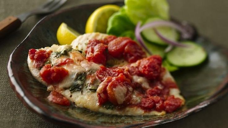 Muir Glen® tomatoes and basil provides a simple addition to a flavorful seafood dinner that's baked to perfection.