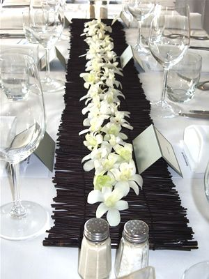 wood runners make a wonderful contrast for a white table and white flowers for a #beach wedding