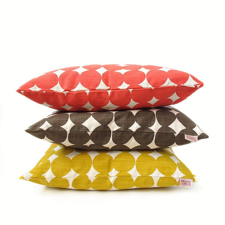 Pebble is part of the Rough Cuts fabric collection. It started out as a paper cutout, inspired by a love of Scandinavian design, and turned into a contemporary pebble pattern.  Available in 3 colours: Pollen Yellow, Lollipop Red & Smudge Grey