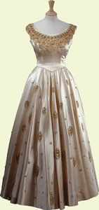Satin evening gown worn by Queen Elizabeth II, designed by Norman Hartnell, English, 1956.